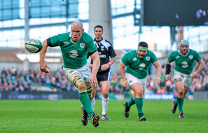 Paul O'Connell chases a loose ball during Ireland's victory against England