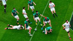 Ireland players, from left, Iain Henderson, Rob Herring, Jack Conan, Conor Murray and Josh van der Flier celebrate a try by Keith Earls during the Guinness Six Nations Rugby Championship match between Ireland and England at the Aviva Stadium in Dublin. Photo by Ramsey Cardy/Sportsfile