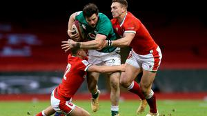 Robbie Henshaw is tackled by Johnny Williams, left, and George North of Wales during the 2021 Six Nations match between Wales and Ireland at the Principality Stadium. Photo: Gareth Everett/Sportsfile
