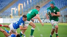 Ireland's Jordan Larmour offloads to team-mate Will Connors, as he is tackled by Italy's Juan Ignacio Brex and Luca Sperandio, to set up the third Irish try during Saturday's Guinness Six Nations match at Stadio Olimpico, Rome. Photo: Roberto Bregani/Sportsfile