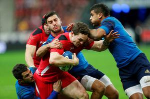 Wales George North is tackled during the RBS Six Nations match at the Stade de France, Paris, France