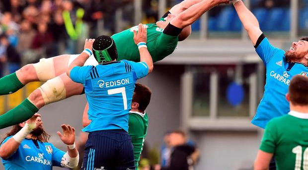 Ireland captain Paul O'Connell fights for the ball with Italy's lock George Biagi during the opening Six Nations clash in Rome on Saturday