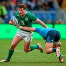 Robbie Henshaw, Ireland, is tackled by Michele Campagnaro, Italy