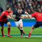 Finn Russell of Scotland moves between Pascal Pape (L) and Yoann Maestri during the RBS Six Nations match between France and Scotland at Stade de France
