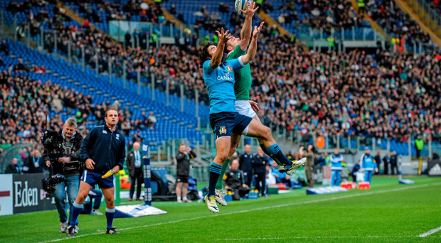Tommy Bowe contests a cross-field kick with Italy's Luke McLean