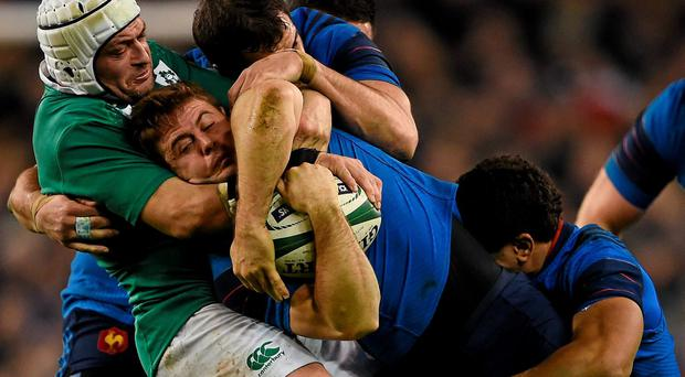 Rory Best tackles Rory Kockott as a host of French players join in