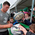 Robbie Henshaw signs autographs for supporters after training in Galway