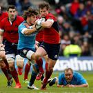 Scotland's Peter Horne and Italy's Luke McLean during the RBS Six Nations match at Murrayfield Stadium, Edinburgh