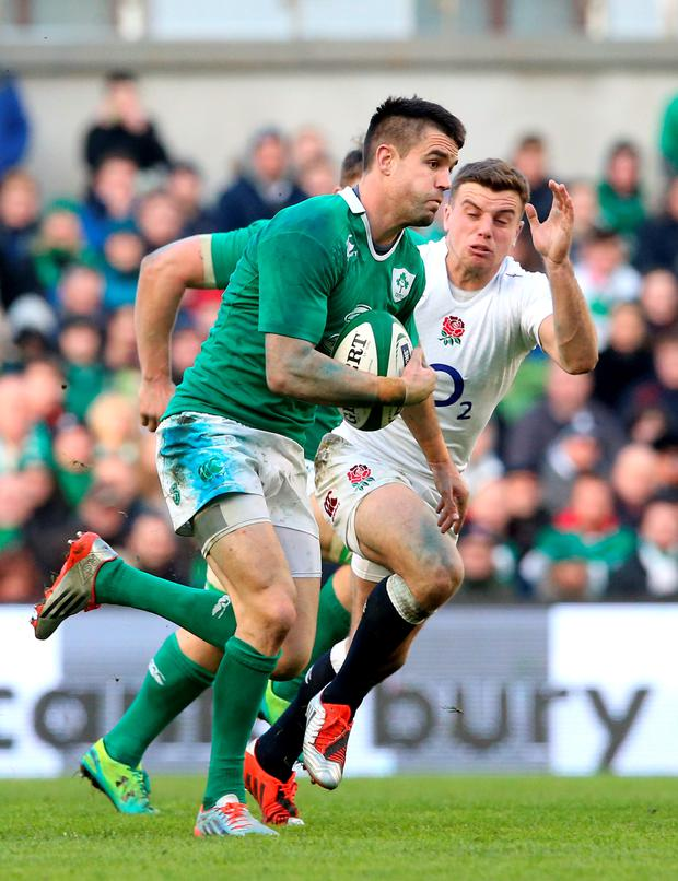 Conor Murray of Ireland is pursued by George Ford of England during the RBS Six Nations match between Ireland and England at the Aviva Stadium