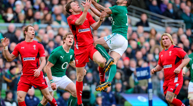 Rob Kearney gets to a dropping ball ahead of Wales out-half Rhys Priestland during last year's game in the Aviva