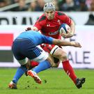 Jonathan Davies of Wales and Wesley Fofana of France in action