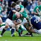 Paul O'Connell is tackled by Scotland's Blair Cowan (left) and Greig Tonks at Murrayfield