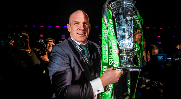 Paul O'Connell parades the silverware after Ireland's men claimed the Six Nations title