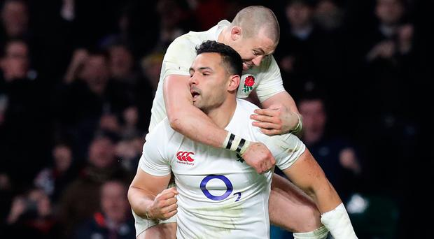 England's Ben Te'o celebrates scoring a try with team-mate Mike Brown. Photo: PA