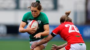 Béibhinn Parsons of Ireland is tackled by Bethan Dainton of Wales during the Women's Six Nations Rugby Championship match between Wales and Ireland at Cardiff Arms Park in Cardiff, Wales. Photo: Chris Fairweather/Sportsfile