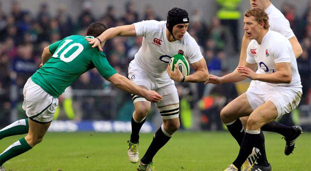England's Tom Wood holds off Jonathan Sexton during their Six Nations rugby match at Aviva stadium in Dublin