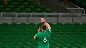 CJ Stander on his smartphone talking to his family after the England match. Photo: Brendan Moran/Sportsfile