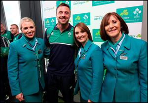 Aer Lingus cabin crew Catherine McDonnell, Lianne Donnelly and Jacqueline Bailey with Tommy Bowe at Dublin Airport yesterday.