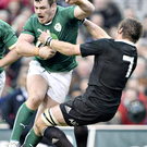 Ireland's Cian Healy barges through the challenge of All Black Richie McCaw during last year's Autumn International Series. A repeat of the match-up - but not the result - would a dream come true for the World Cup final in 2023.