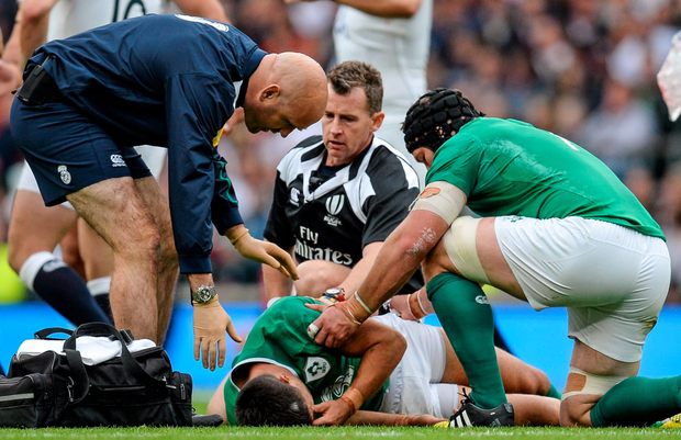 Conor Murray receives treatment before leaving the field yesterday Photo: Matt Browne