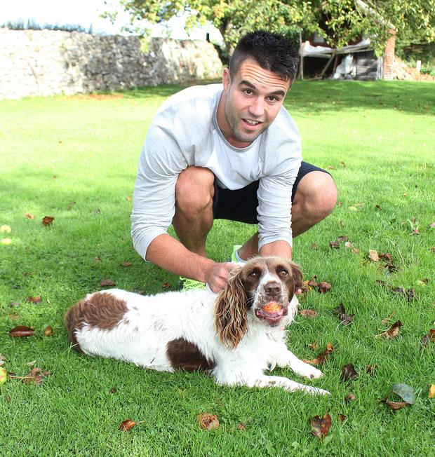 Conor Murray back home in Limerick with his dog Freddie.