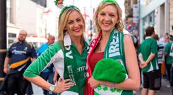 Celebrating the opening Irish game at the Rugby World Cup in Cardiff were Anna and Emily Tully