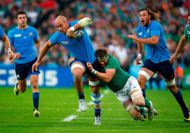 Italy's Sergio Parisse is tackled by Jamie Heaslip during yesterday's Pool D clash at the Olympic Stadium GETTY IMAGES