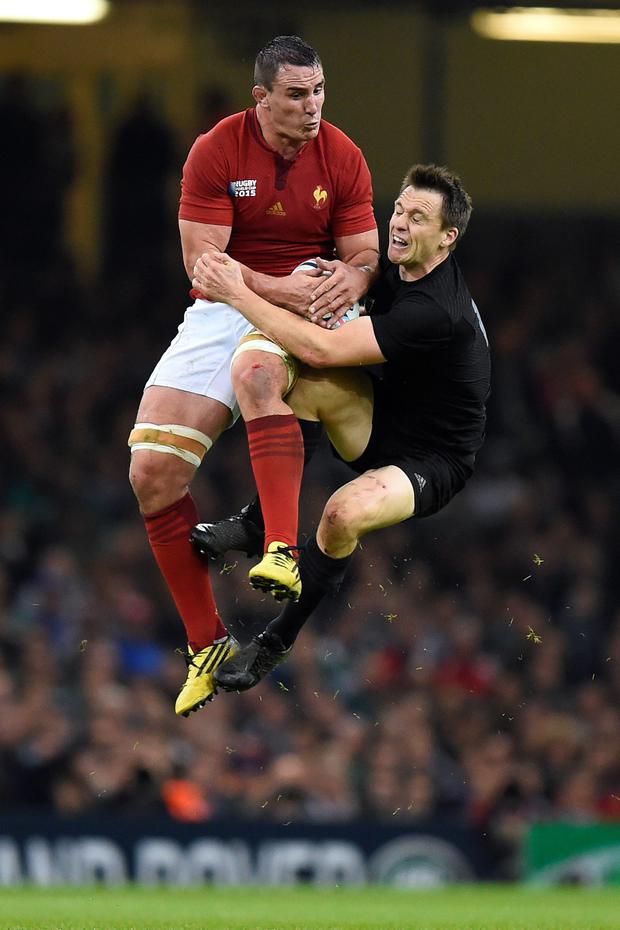 France's Louis Picamoles and New Zealand's Ben Smith battle for the ball in the air after the restart during last night's World Cup quarter-final in Cardiff