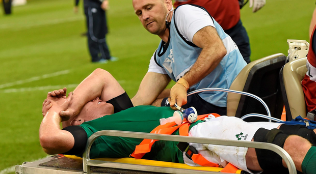 Paul O'Connell leaves the pitch with Dr Eanna Falvey