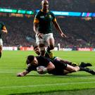 New Zealand's Beauden Barrett scores his side's second try during the Rugby World Cup semi-final at Twickenham