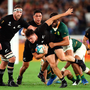 Powerhouse: George Bridge of New Zealand is tackled as he goes for the line during the All Blacks' Group B against South Africa in Yokohama. Photo: Getty Images