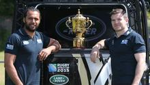 Gordon D'Arcy and Isa Nacewa pose with the RWC 2015 Defender as it brings the Webb Ellis Cup to Old Belvedere