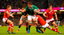 Ireland lock Iain Henderson is tackled by Kyle Gilmour of Canada during their World Cup Pool D opener in Cardiff on Saturday