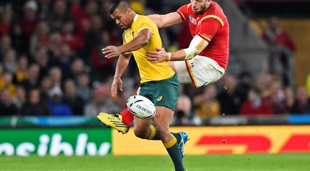 Australia's Kurtley Beale and Alex Cuthbert of Wales challenge for the ball during yesterday's Pool A match