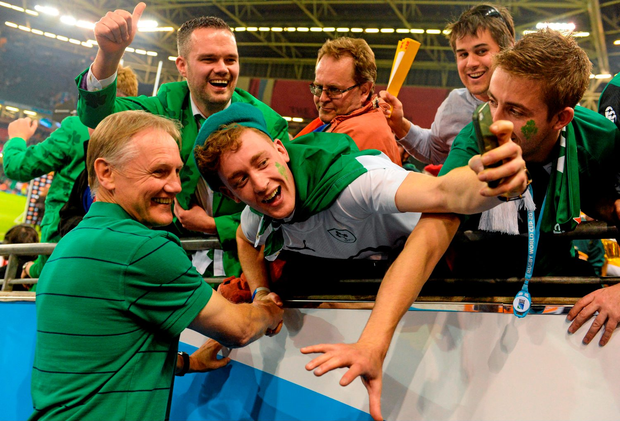 Joe Schmidt poses for a photo with fans after the victory