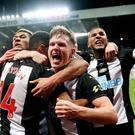 Newcastle's Isaac Hayden, second left, celebrates scoring a late winner against Chelsea (Owen Humphreys/PA)