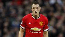 Phil Jones has not given up hope of Manchester United challenging for the title