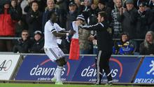 Bafetimbi Gomis, left, celebrated Swansea's equaliser with a French flag in memory of those people killed in the Paris terror attacks