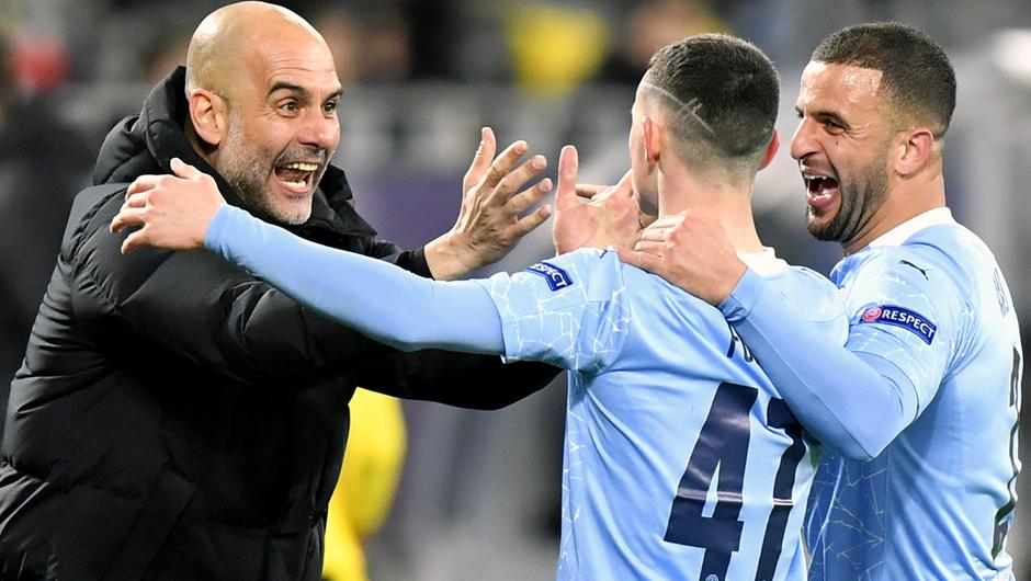 Guardiola (left) has guided City to the Premier League title and the Champions League final in a difficult season (PA Wire via DPA)