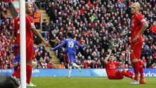 Chelsea's Diego Costa, centre, celebrates scoring the winner as Liverpool's players look on