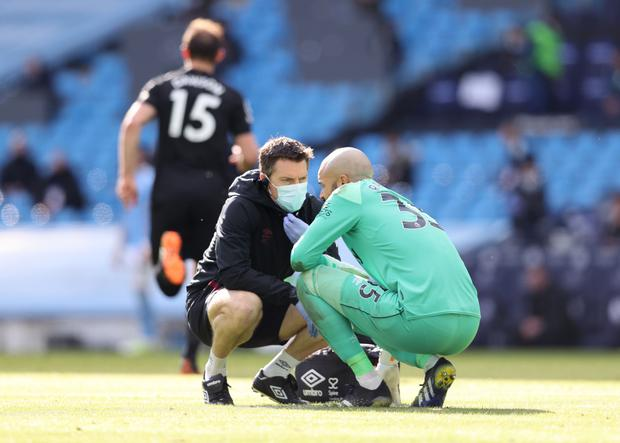 West Ham United's Darren Randolph receives medical attention against Manchester City last Saturday. Photo: Clive Brunskill/Reuters