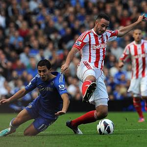 Marc Wilson, right, says Mark Hughes 'has done a great job wherever he's been'