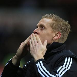 Garry Monk acknowledges the Swansea fans after masterminding a 3-0 win over Cardiff