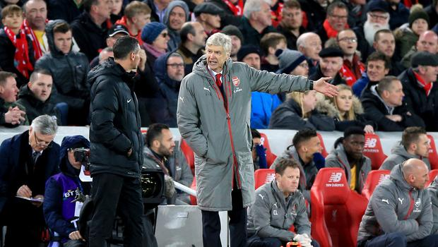 Arsene Wenger shows his frustration during Liverpool's 3-1 win at Anfield