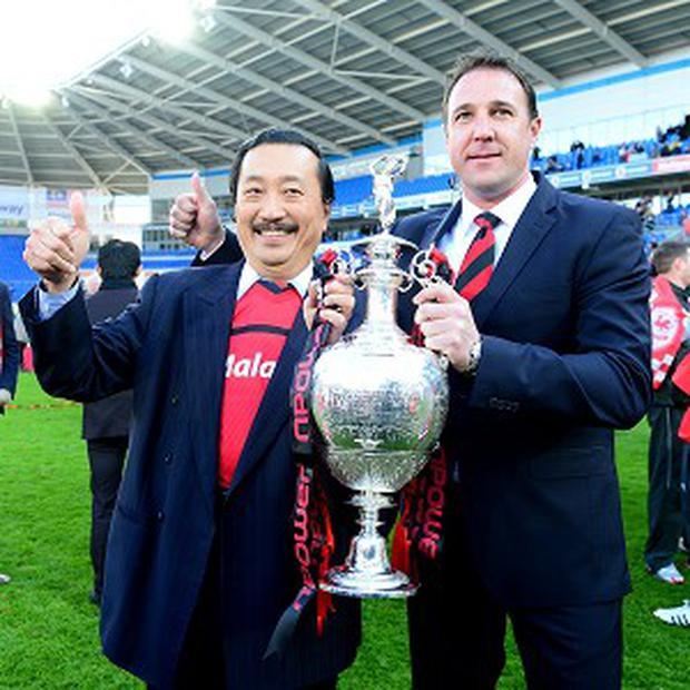 Vincent Tan, left, has backed Malky Mackay, right, to lead Cardiff in the Premier League this season