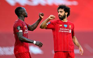 Liverpool's Mohamed Salah with Sadio Mané celebrate against Crystal Palace