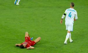 Mohamed Salah, left, lies injured after a challenge from Sergio Ramos the 2018 Champions League final (Peter Byrne/PA)