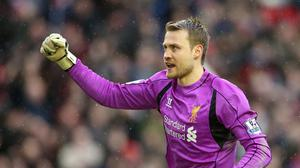 Liverpool goalkeeper Simon Mignolet says the team's fighting spirit is driving their push for a top-four spot