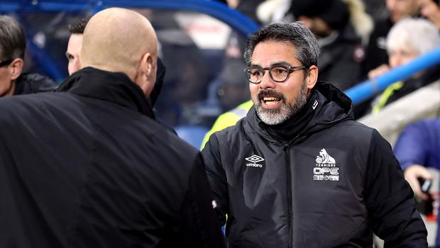 Burnley manager Sean Dyche and Huddersfield Town manager David Wagner (right) shake hands before the Premier League match at the John Smith's Stadium, Huddersfield.