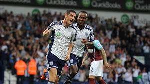 West Bromwich Albion's Graham Dorrans (left) celebrates with Saido Berahino after scoring his sides fourth goal of the game against Burnley.